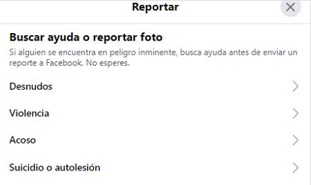 Cómo eliminar la cuenta de Facebook de otra persona. Al reportar una fotogragía etiquetada. Paso 3